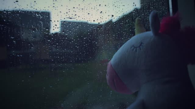 4K Trendy Unicorn Soft Toy Watching Sad Rain video