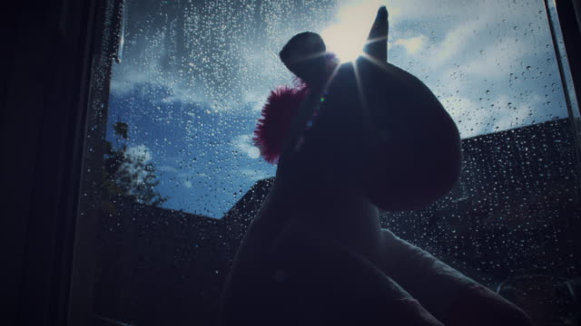 4K Trendy Unicorn Soft Toy Watching The Window video