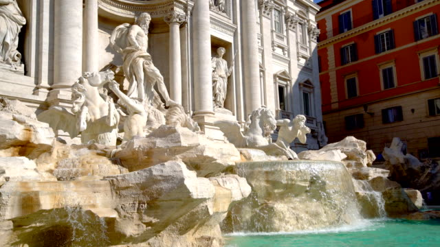 Trevi Fountain in Rome , Italy The Trevi Fountain is a fountain in the Trevi district in Rome, Italy. It is the largest Baroque fountain in Rome and one of the most famous fountains attracting tourist visiting Rome. fountains stock videos & royalty-free footage