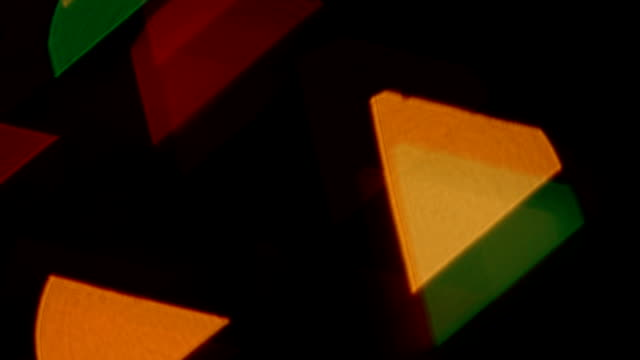Triangles. Defocused lights background video