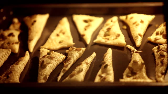 Triangles of puff pastry inside oven Triangles of puff pastry inside oven, baking tray inflate Baked and rouge time Lapse pastry dough stock videos & royalty-free footage