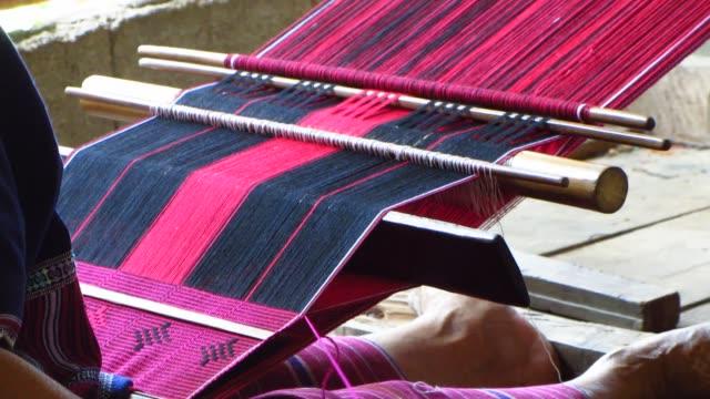Tribal Woman Weaving a Scarf video
