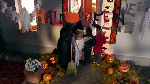 HD CRANE: Trick Or Treating At Night video