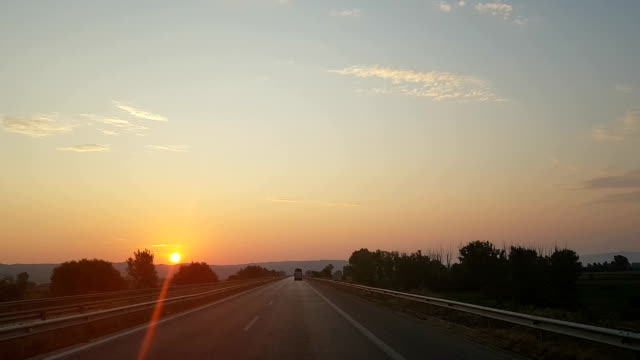 A trip on road in the sunset A trip on road in the sunset angle stock videos & royalty-free footage
