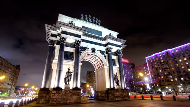 Triumphal arch in Moscow with Christmas illuminations at night timelapse hyperlapse video