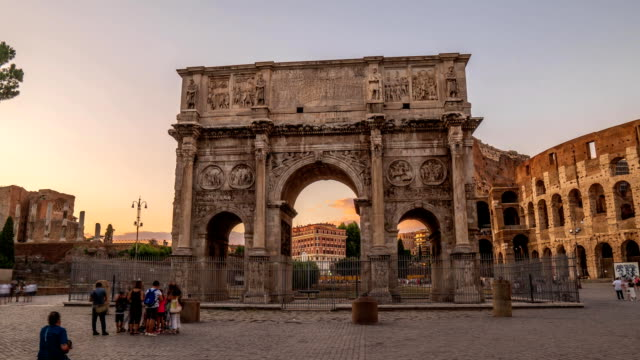 ROME, ITALY - CIRCA Triumphal Arch of Constantine near Colosseum in Rome, Italy. Tourists walking near attraction