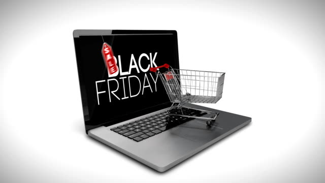 Trolley with boxes on laptop displaying black Friday sale sign