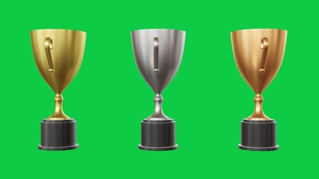 vídeos de stock, filmes e b-roll de troféus prata dourada bronze tela verde - troféu