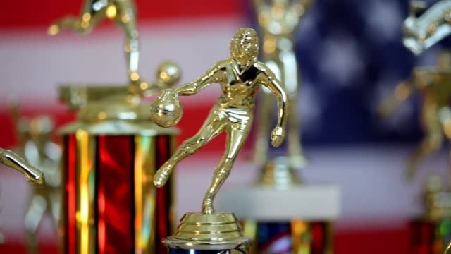Trophies with American Flag background video