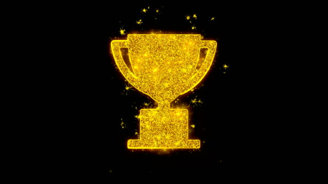 trophy win cup icon sparks particles on black background. - championship stock videos & royalty-free footage