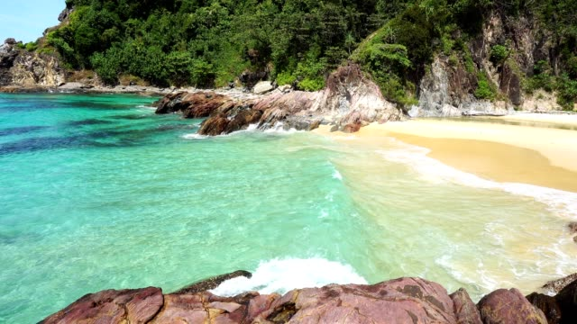 tropical andaman seascape scenic off beautiful beach in thailand with wave crashing on sandy shore - phuket video stock e b–roll