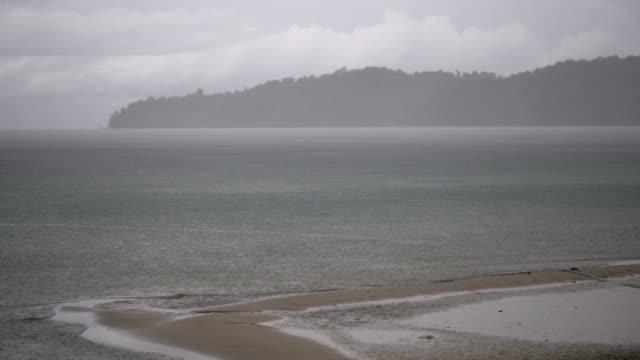 Tropical beach sand during torrential rain video