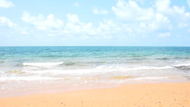 Tropical beach sea with soft waves and smooth sand. Tranquility and fresh air for relaxing time on sunny day.