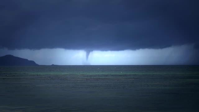 tropical cyclone seen from beach - tornado video stock e b–roll