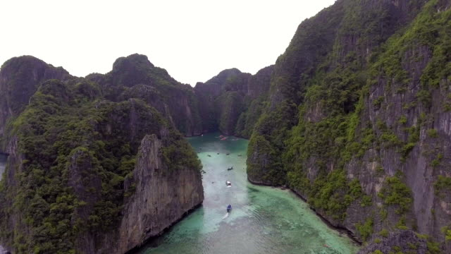 Tropical Emerald Lagoon with Crystal-clear Water in the Cliff of Phi Phi Lae Island, Thailand video