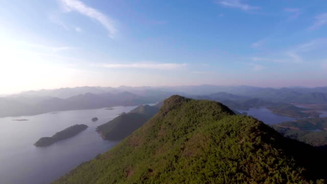 Tropical green mountain and lake with blue sky, Aerial video video