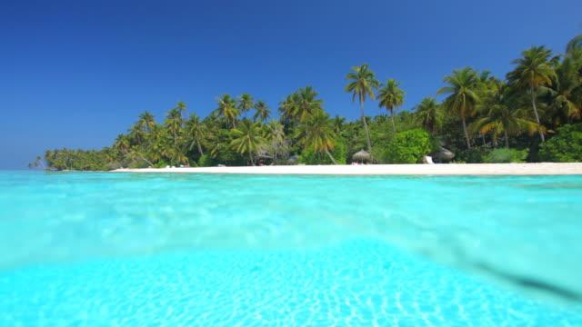 tropical island split shoot lagoon and beach video