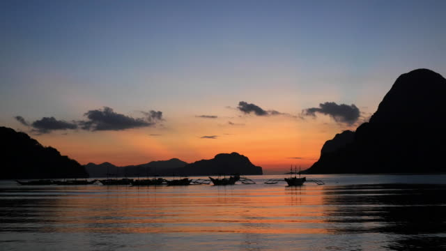 Tropical landscape with traditional Philippines boats at sunset. Philippines video