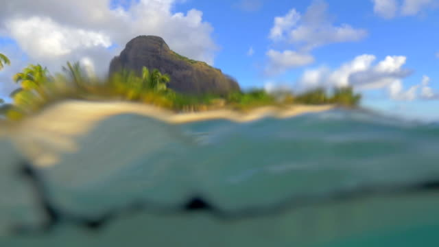 tropical resort on mauritius, view from water - isole mauritius video stock e b–roll