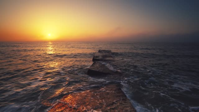 Tropical sunrise on the beach. Sea rising up over ocean waves. Tropical sunrise on the beach. Sea rising up over ocean waves. high dynamic range imaging stock videos & royalty-free footage