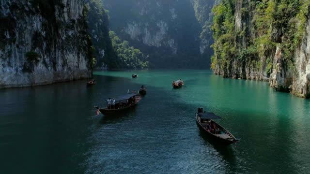 tropical thai jungle lake cheo lan drone flight, wild mountains nature national park ship yacht - isole mauritius video stock e b–roll