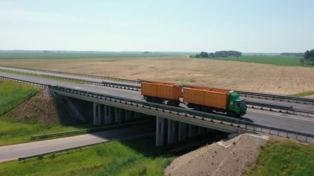 Truck Driver Carrying Cargo On Speed Intercity Highway On Bridge Aerial View