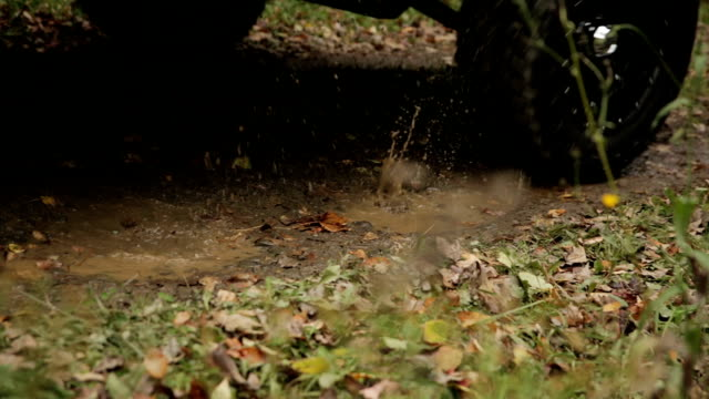 Truck Drives Through Mud Puddle Rack Focus video