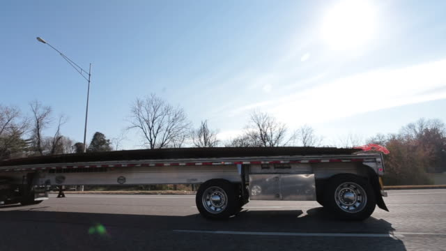 Truck driving on highway during beautiful day