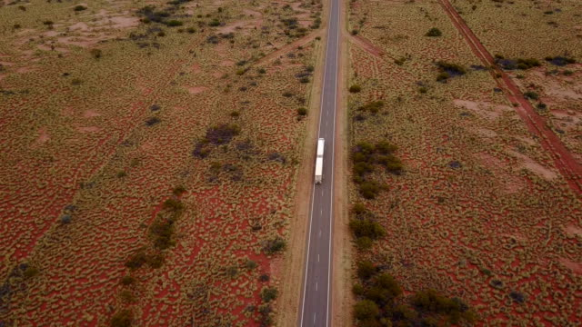 Truck driving on road aerial view video