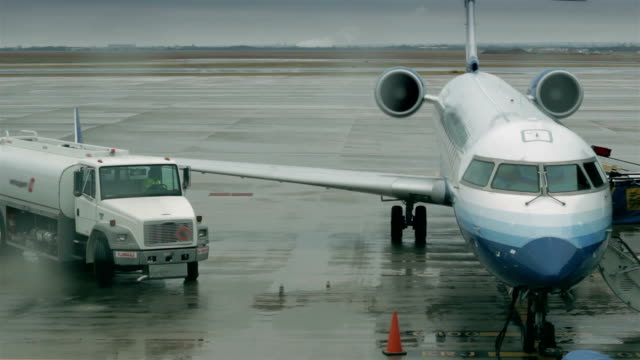 Truck leaves after servicing airplane video