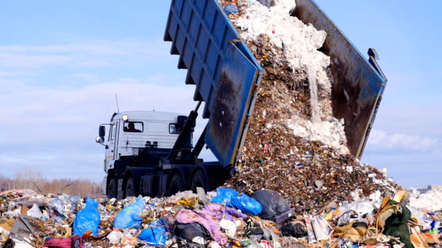 4K. Truck offloading waste into a huge landfill. video