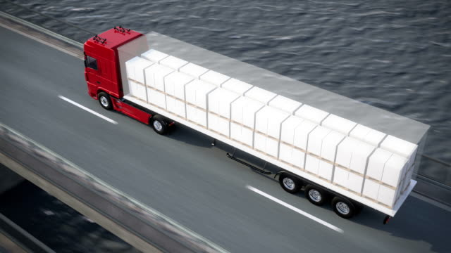 truck on bridge revealing its load video
