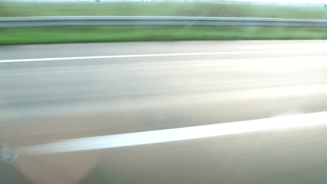 Truck passes a moving car on highway video