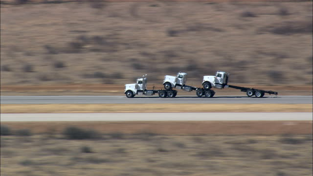 Truck Towing Two Trucks On Route 82  - Aerial View - Texas,  Baylor County,  United States This clip was filmed by Skyworks on HDCAM SR 4:4:4 using the Cineflex gimbal. Texas,  Baylor County,   United States towing stock videos & royalty-free footage