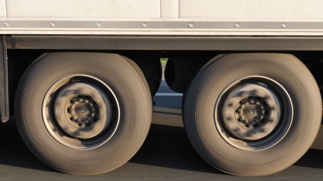 truck wheels and tires with suspension on high speed on highway - truck tire video stock e b–roll