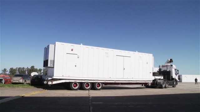Truck With Heavy Load. Truck with White Container.