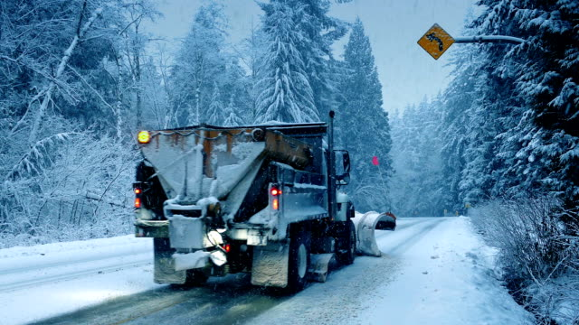 truck with snowplow and cars drive past - salt video stock e b–roll