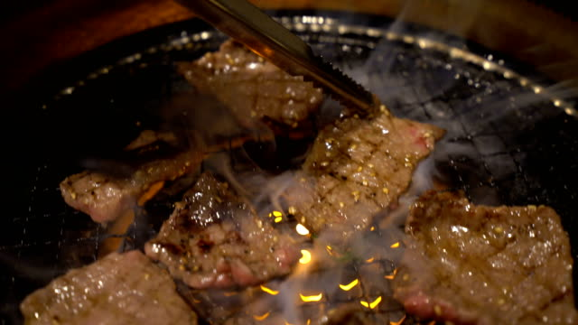 4K Trucking shot Cooking meat on japanese barbecue grill