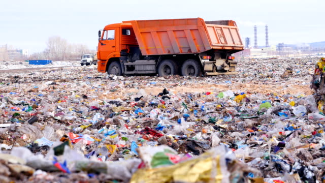 Trucks at a huge landfill. Trucks at a huge landfill. 4K dump truck stock videos & royalty-free footage