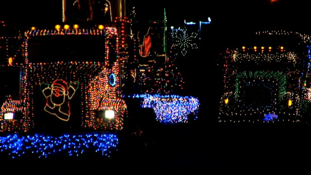 Trucks in lighted vehicle parade video
