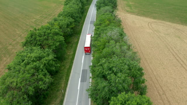 Trucks on a country road - drone POV