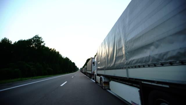 Trucks wait in line on border crossing control video