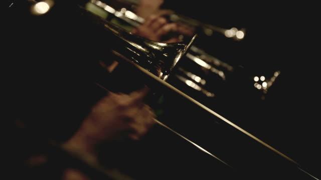 Trumpet and trombone playing jazz music video