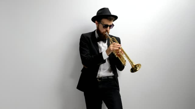 Trumpet player against a wall video