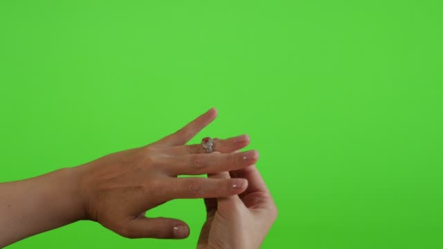 trying silver ring with red stone on tower in front of green screen display 4k 2160p ultrahd footage - greenscreen chroma key background silver ring presenting 4k 3840x2160 uhd video - key ring stock videos & royalty-free footage
