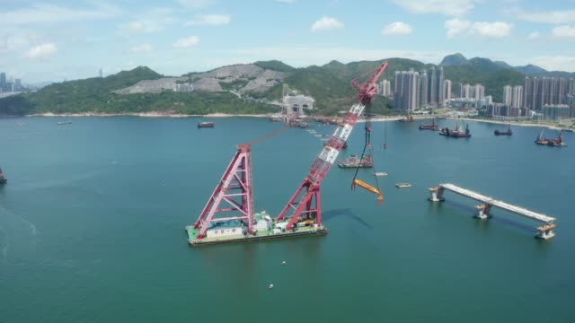 Tseung Kwan O - Lam Tin Tunnel project in Hong Kong view of marine works of the Cross Bay Link at Tseung Kwan O is seen. The Link is a bridge connecting LOHAS Park area with the Tseung Kwan O-Lam Tin Tunnel. civil engineering stock videos & royalty-free footage