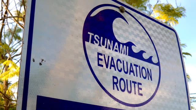 Tsunami Hazard Zone Evacuation Warning Sign A Tsunami Hazard Zone warning sign near the waters edge in Koh Lanta, Thailand.  The instruction being in case of Tsunami, go to high ground or inland.  These advisory evacuation signs were erected following the Indian Ocean Tsunami on 26 December 2004, where 230,000 people were killed in 14 countries.  They are written in Thai and English and are common place throughout coastal areas.  This one is located on Ko Lanta, Krabi. practice drill stock videos & royalty-free footage