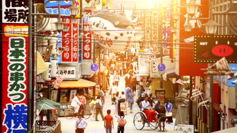 Tsutenkaku Tower in Osaka Japan Real time video of people walking the streets of Tsutenkaku Tower in Shinsekai district of Osaka in Japan. famous place stock videos & royalty-free footage