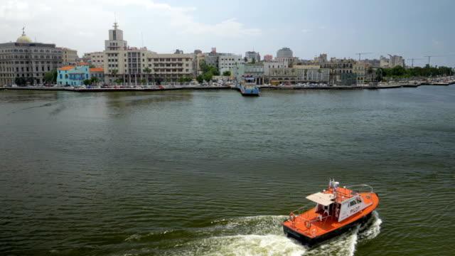 Tug Boat in Havana Port Bay with City Skyline in Background video