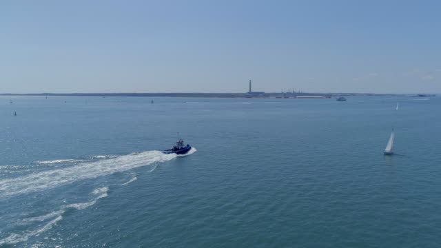 Tug Boat Moving Through the Sea in the Summer